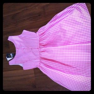 A dress with good fabric. It is a dress with butto